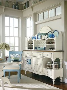 coastal dining...Think I could reproduce this look with an old headboard, some crates, maybe a plate rack and an old buffet.  Even an old cupboard-add feet with a couple of side tables or fancy nightstands bolted together and a new top. Could be a fun project.