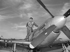National Guard pilot Bill Yoakley posing on the wing of a plane: Jacksonville, Florida by State Library and Archives of Florida, via Flickr