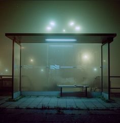 Todd Hido. I love this combination of an eerie colour palette and bright lights