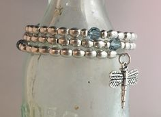 Wrap style, pewter with SS beads & charms, Preciosa crystals.