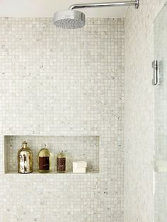 Gorgeous shower design with wall to wall Carrara marble mini mosaic tile and tiled recessed shelf for showering essentials! The shower features a glass door and polished chrome rain fall shower head. Bathroom Shower Organization, Laundry In Bathroom, Small Bathroom, Bathroom Ideas, Bathroom Niche, Bath Ideas, Bathroom Designs, White Mosaic Bathroom, Modern Mosaic Tile