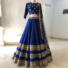 Blue Colour Taffeta Silk Fabric Party Wear Lehenga Choli Comes with matching blouse. This Lehenga Choli Is crafted with Embroidery This Lehenga Choli Comes with Unstitched Blouse Which Can Be Stitched. Indian Fashion Dresses, Indian Gowns Dresses, Dress Indian Style, Indian Designer Outfits, Indian Outfits, Indian Wedding Dresses, Indian Reception Outfit, Blue Dresses, Wedding Hijab