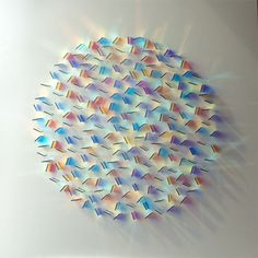 Patterns of Light by Chris Wood.  Cambridgeshire-based artist Chris Wood's beautiful, geometric arrangements of colorful glass create dazzling reflections and projections of light.