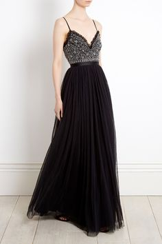 NEW AND EXCLUSIVE TO NEEDLEANDTHREAD.COM. Our Christmas story begins with the NEW Andromeda Maxi Dress in washed black. Inspired by antique french lace, this embellished tulle bridesmaid maxi dress features tiny silver cut beads and a ruffled trim that delicately frames the neckline.