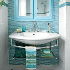 Choose design elements that open up a small bath so you don't feel cramped, such as mosaic tile. Use a medicine cabinet with a mirror and add a shelf below the sink.