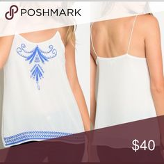 The Sanibel🐚🐚 White/Blue Embroidered Top Fabulous white and blue embroidered camisole style top.  100% polyester.  Simply beautiful for the hot Summer styled with cute cutoff denim shorts🏝🏝 Lemon's Lovelies Tops