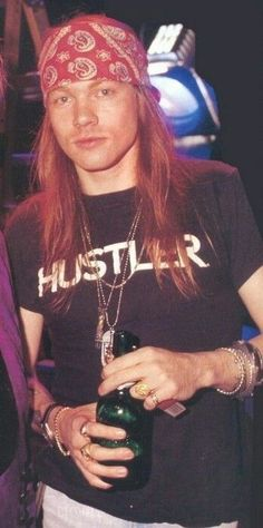 """AXL ROSE of GUNS AND ROSES with HUSTLER T-shirt  """"The World's No:1 Online Heavy Metal T-Shirt Store"""". Check it out our Metalhead Clothing and Apparel Store, Satanic Fashion and Black Metal T-Shirt Stores; www.HeavyMetalTshirts.net"""