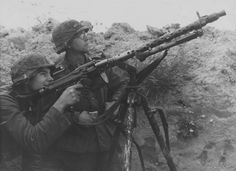 Two Norwegian soldiers from the Den Norske Legion photographed on the Leningrad Front with a MG 34 machine gun mounted on an anti-aircraft tripod, summer of 1942.