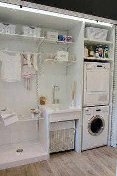 Organized laundry area. A place for everything - best layout I've seen so far! I can picture a mudroom type bench with hooks and shelves on the opposite wall.