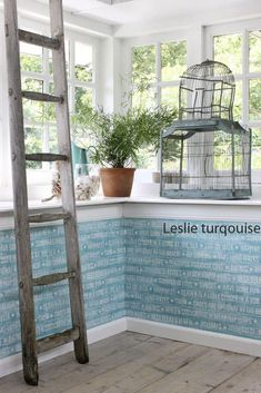 Going for a playful rustic shabby chic nautical look? Seafoam turquoise is a fool proof colour to conjure the feeling of ocean water. This wallpaper is a faux wood with beach life text - fun! Graphic Wallpaper, Trendy Wallpaper, Blue Wallpapers, Home Decor Shops, Home Decor Items, Ibiza, Wood Effect Wallpaper, Wall Design, House Design