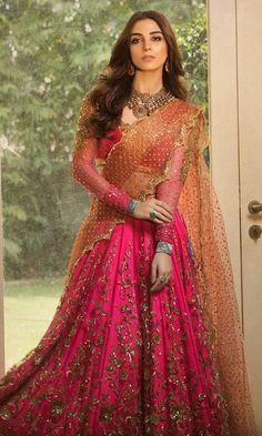 Pakistani wedding dresses in UK collection has this beautiful and ravishing dress in neon pink color. This dress has beautifully embellished pink tissue Lehenga with crop choli with gold embellishments. Pakistani Wedding Outfits, Indian Bridal Outfits, Pakistani Wedding Dresses, Pakistani Dress Design, Indian Designer Outfits, Wedding Lehnga, Wedding Updo, Wedding Reception, Designer Bridal Lehenga