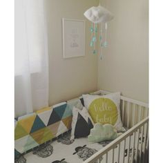 Cloud mobile by the fab @Jahje Ives of Baby Jives Co., mountain and cloud pillows by @juniper_wilde, sheet, blanket and hello baby pillow by @Angela Anglin Hansen