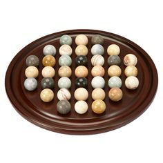 Marble solitaire, sometimes called Venetian solitaire, is designed with assorted marbles and wood in our exclusive version. Marble solitaire game challenges the player to rid the wood circle of marbles. This handsome tabletop design adds a decorative accent to a den, living room or game area.