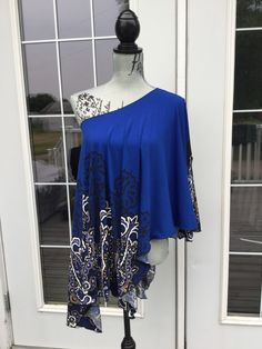 Royal blue poncho style original Lucylu wrap is so cute and classy.  Super comfy and soft!  Great print detail with just a hint of gold!!! One size fits most.  Great over a t shirt, camisole or tank to, or as a swimsuit coverup!  Great for a nursing mama too!