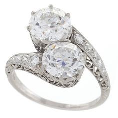 Early Art Deco Diamond Platinum Crossover Ring | From a unique collection of vintage engagement rings at https://www.1stdibs.com/jewelry/rings/engagement-rings/