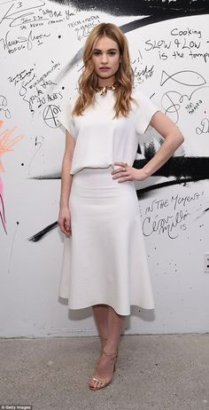 Lily James.. Camilla and Marc blouse and skirt, Jimmy Choo heels, and Jennifer Fisher necklace..