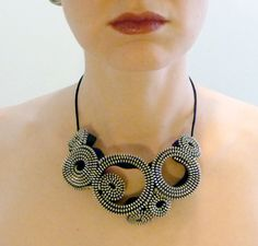 8 Silver Circles Zipper Necklace by horseflesh (HFP), the works of Camilla Taylor