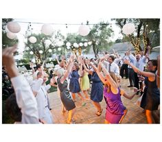 guests dancing at reception.