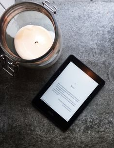 Kindle Books and Candle - reading for cultivating winter magic Kindle, The Snow Child, Candle Reading, Prepped Lunches, Winter Magic, Another World, Meals For The Week, Desks, Coffee Shop
