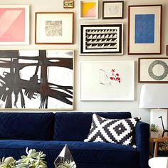 Note how the art is grouped around the sofa and lamp.