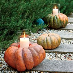 Keep it Simple  |  If you love the look of hurricanes lining a front path, put an autumn spin on them by using oversize heirloom pumpkins in various shades of orange and green as bases—perfect for welcoming guests to a fall-themed party.