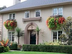 SECOND STORY WINDOW BOXES. If your first-level windows are obstructed, create massive window boxes on second-story windows.