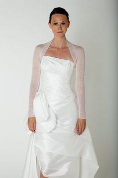 I thin this is the winner.   Summer Wedding Bolero knitted in one piece by Weddingbolero, €100.00