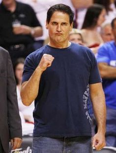 Dallas Mavericks owner Mark Cuban cheers before his team plays the Miami Heat in Game 6 of the NBA Finals basketball series in Miami, June 12, 2011.