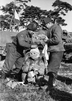 <strong>Not published in LIFE.</strong> Turkish soldiers attend to a wounded prisoner, Korea, 1951.