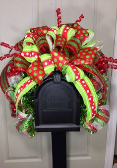 Fits most standard mailboxes! Designed with mesh, ribbons, and all the trimmings! All wreath materials are wired or/and glued with durable professional glue. While we do spray all our wreaths with a protectant to help fight against fading, we do recommend a covered porch or stoop to help to better protect your wreath from the elements.