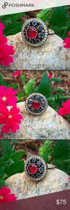silver, gold with ruby, sapphires and topaz ring This ring has a very boho genie vibe. The ruby has a dusky earthy-ness and the sapphires and topaz are very bright! The band has a pretty beaded texture and there are lovely cut outs around the medallion. It is sterling silver with some gold accents, really unique and beautiful! Size 7 3/4 Jewelry Rings