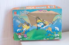 Vintage Smurfs Puzzle Pap Smurf Hang Gliding Smurfette | MollyFinds Vintage Gifts, Vintage Toys, Scary Funny, Smurfette, Hang Gliding, Retro Toys, Simple Gifts, Alice In Wonderland, Childrens Books
