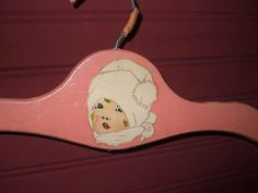 VINTAGE CHILDS WOODEN CLOTHES HANGER PINK VICTORIAN GIRL WITH WHITE SNOW HAT 1940-1950s listed for sale on eBay! SOLD!!