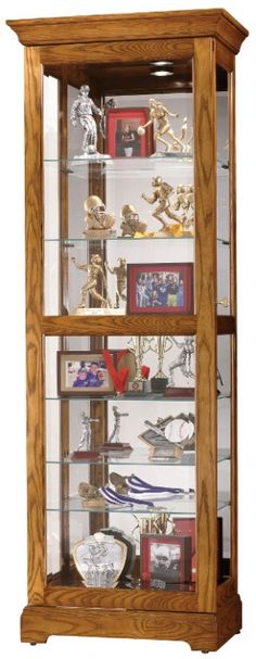 Moreland Curio Cabinet with Sliding Door in Legacy Oak Finish