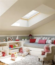 Attic childrens play space with daybed and trundle ~ Stebbing House Desing