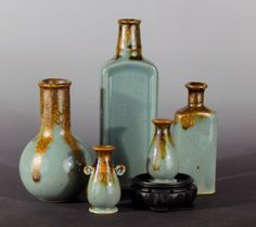 Jon Loer, 2014, stoneware slip cast antique bottles with celadon glaze fired in reduction atmosphere
