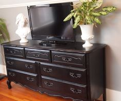 Refurbished furniture - I like this in black for a tv stand!