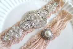 A very romantic, blush/nude gatsby ornate vintage style beaded applique heirloom wedding garter set with ostrich feather.    ** Hand beaded romantic