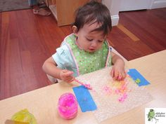 Edible paint is the best! Our friends painted with it on top of bubble wrap for textured, sensory-oriented fun. To make:  Mix 1/2 tsp salt + 1/2 cup cornstarch + 3 tbs sugar + 2 cups water in a small saucepan until mixture thickens. Add food coloring and enjoy!  — Alphabet Academy South Toddlers  http://thealphabetacademy.com  #reggio-inspired #edible #paint #cornstarch #bubblewrap #sensory #toddlers