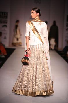 A gorgeous gold and white piece by Joy Mitra #wifw #ss14 #fdci #infashion #fashion #trends #fashionweek #joymitra