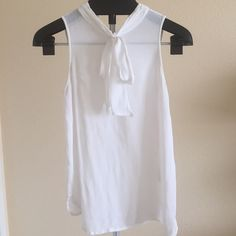Forever 21 Sheer Tank  Sheer Forever 21 tank with high collar and bow  Two button closure at back of neck. Missing one button as seen in photo and priced accordingly.   ✖️ PAYPAL  ✖️ TRADES  ✔️ BUNDLES Forever 21 Tops Tank Tops
