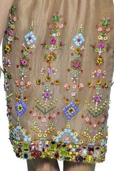 Gorgeous beading and embroidery...I love the colors on the beads against the neutral material