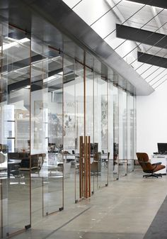 rosewood-edged glass blades and pivot doors, Fabric Warehouse by Fearon Hay, Auckland NZ
