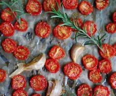 Garlic and Rosemary Slow Roasted Tomatoes are a flavorful alternative to canning for preserving tomatoes. Use in paleo pasta, salads, or on paleo pizzas.