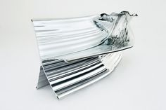 Bench from a single piece of extruded aluminum. By Heatherwick Studios. Very Terminator 2.