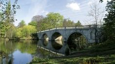 Clumber bridge in Clumber Park, designed by Stephen Wright in 1770 and built of local limestone in the Palladian style, with three semicircular arches