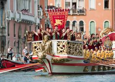VENICE, ITALY - SEPTEMBER 05:  Venetian wearing costumes reproducing outfits dating back 1489 take part in the Historic Regata in Venice, Italy. The Historic Regata is the most exciting rowing race on the Gran Canal for the locals and one of the most spectacular.