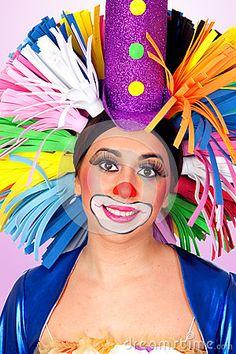 Funny girl clown with a big colorful wig by Jose Manuel Gelpi Diaz, via Dreamstime