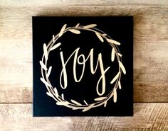 Joy wreath canvas- 12x12 black sign with 14 karat gold leaf, metallic silver, or white lettering All items are custom painted and hand lettered.