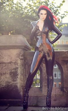 starfucked:  Model: StarfuckedPhotographer: Belinda Bartzner - Photography Catsuit: mad duck designs Latex FactoryBoots: www.skofeber.se